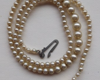 Vintage Graduated Faux Pearl Necklace With A Silver Clasp