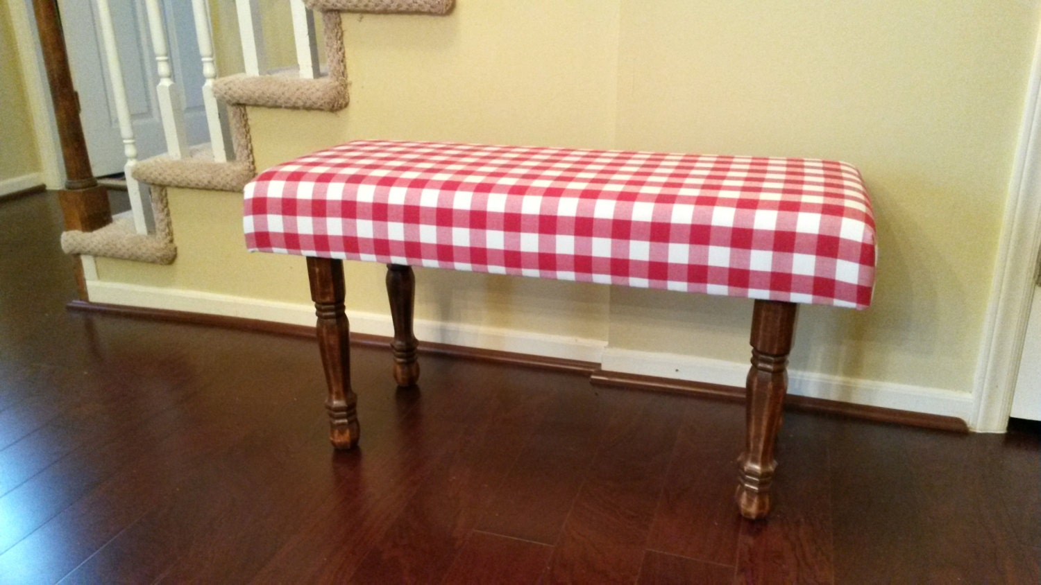 Upholstered bench red and white gingham White upholstered bench