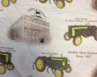 Various John Deere tractors on light tan background and Moline, Ill factory.