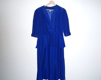 Blue 3/4 sleeve 80's dress with ruffle at the waist and hem