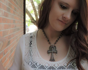 Silver filigree cross and angel wing necklace