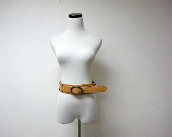 wide cow leather studded belt . made in USA . small