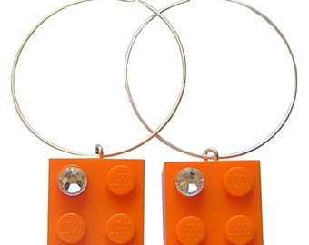 Orange LEGO (R) brick 2x2 with a Diamond color SWAROVSKI crystal on a Silver/Gold plated hoop