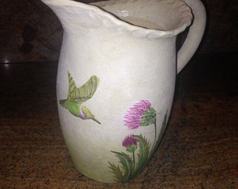 Pitcher with flowers and hummingbird