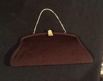 Brown fabric clutch handbag