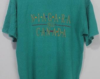 Vintage 80s Niagara Falls Canada souvenir collection sewn gold retro tee shirt