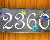 Whimsical slate house number sign with birds, flowers and swirls.