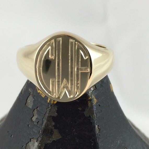 three initials engraved 9 carat yellow gold oval signet ring
