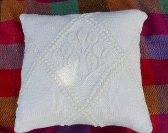 Aran cushion, hand knit