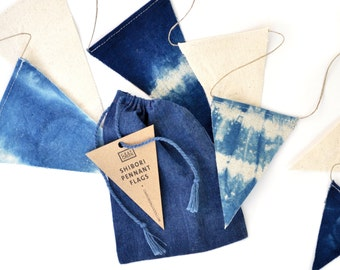 Shibori pennant flags—nautical-inspired, indigo and natural canvas bunting flags, with a natural hemp cord—garland comes in an indigo bag