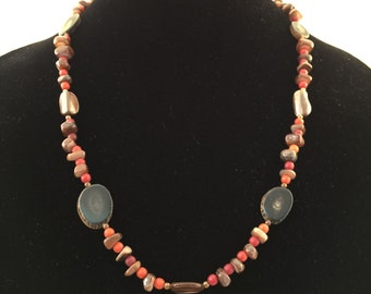 Polished stone necklace in reds and browns
