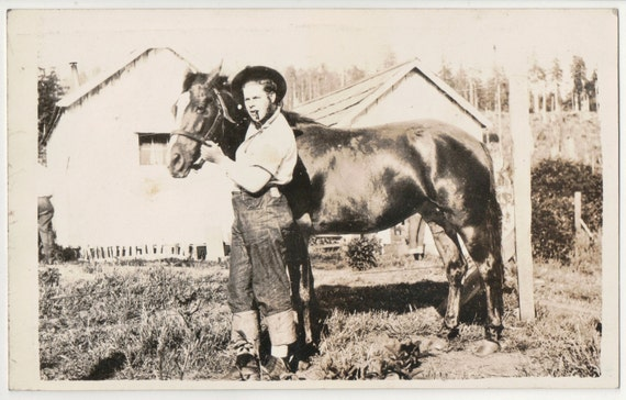 Man with Horse - Man is Smoking Pipe and Wearing Jeans with Rolled up Cuffs Real Photo Postcard
