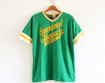 1970s Empire Sporting Goods Greenpoint Chiropractic Center jersey v-neck t-shirt
