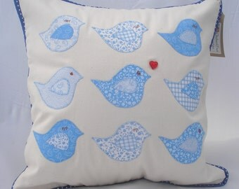 Handmade appliqued cushion with nine unique and happy bluebirds