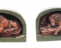"""Llion of Lucerne"""" Swiss bookends 7 1/4"""" x 5' x 2 1/8"""", weight 15.8 lb, Inscribed, Circa 1920's"""