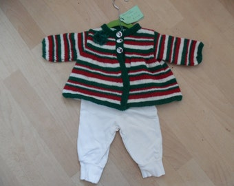 Christmas Stripes, a festive, hand knitted, stripey cardigan with a fabric flower as decoration.  To fit a child aged 3-6  months