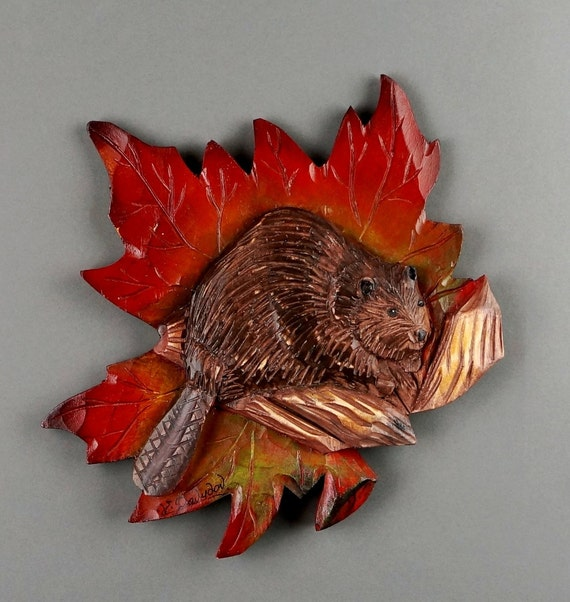 Souvenir from canada maple leaf beaver carved on wood by
