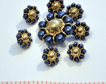 button blue flower in the center golden