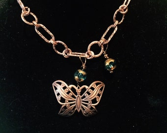 "16"" Artisan necklace. Butterfly and beads wired to brass chain."