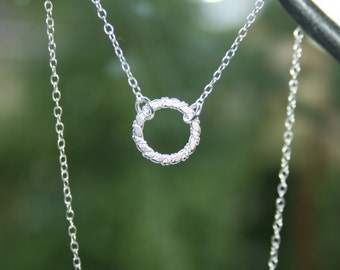 Sterling silver Karma circle necklace. Twisted circle necklace