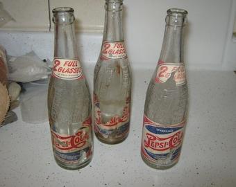 Vintage paper wrapped Pepsi Bottles