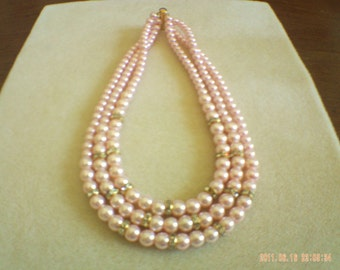 3 strand glass pearls necklace.
