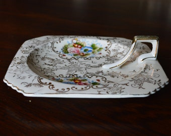 Hand painted gold embossed single handle china dish