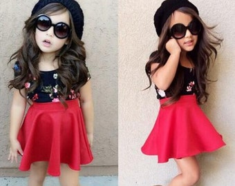 Black Flower Top and Red Skirt