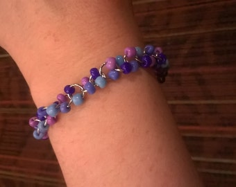 "Blue, Purple, and silver glass beaded bracelet 7"""