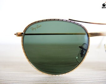 vintage ray bans sunglasses  ray ban vintage sunglasses w1754 vintage nos made in usa gold frame round caravan