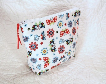 Small makeup bag, water resistant bag, gadget bag, cosmetic bag, coin purse, cute butterfly fabric and perfect for travel, pool, beach.
