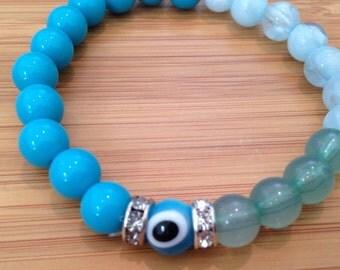 Blue and teal evil eye repurposed bracelet