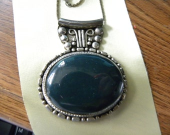 Large  green stone pendant.