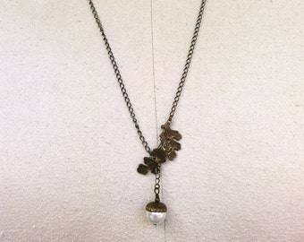 necklace with antique brass oak leaf and pearl acorn drop