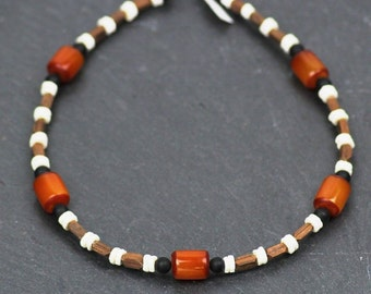 TSUMKWE 2 - African necklace made of hand-carved wood beads/ostrich egg plates/Onyx / amber malingerer