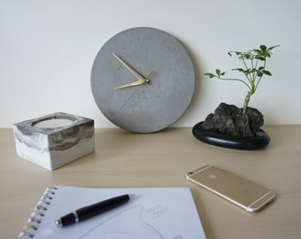 Raw grey concrete clock