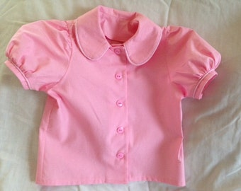 Pink puffed sleeve blouse
