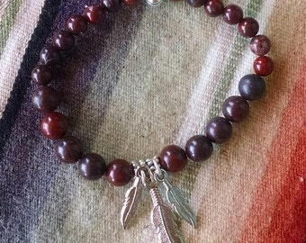 Feather accented blood red Jasper bracelet