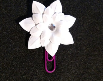 White paper flower with pink paper clip