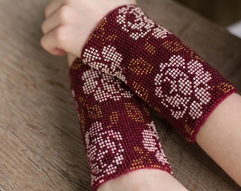 Hand-knitted brown color wrist warmers decorated with brown/white/yellow beads