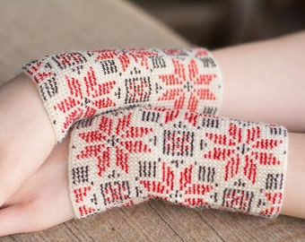 Hand-knitted white color wrist warmers decorated with red/white/gray beads