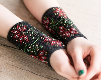 Hand-knitted black color wrist warmers decorated with green/red/white/black/yellow beads
