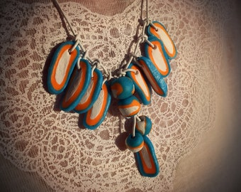 Multi coloured fimo necklace  SNOWBALL in blue, white and orange details. Polymer clay, leather string, adjustable length. Bright.