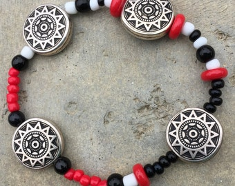 The Stackables. #BR36.Elastic bracelet. Red,white,black glass beads.Antique silver plated metal beads.