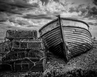 "A dramatic fine art photographic Giclée print ""Boat and Lobster Pots"" on the shingle at Dungeness"