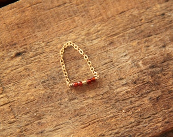 Ring chain gold filled with garnets