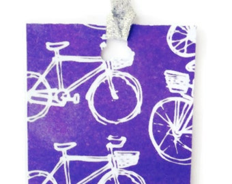 Funky Bicycles Bookmarks with a Metallic Silver Bookmarks Tail and Butterfly Punch Hole