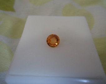 Loose Approximately .65ct 5.5mm Round Mandarin Garnet