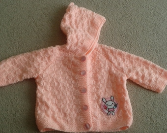 Handknitted baby jacket with hood and motif. This item can be made to order in the colour and size of your choice, Prices may vary