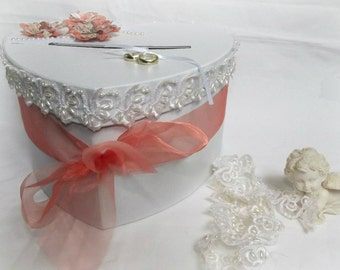 Romantic white and peach wedding urn style